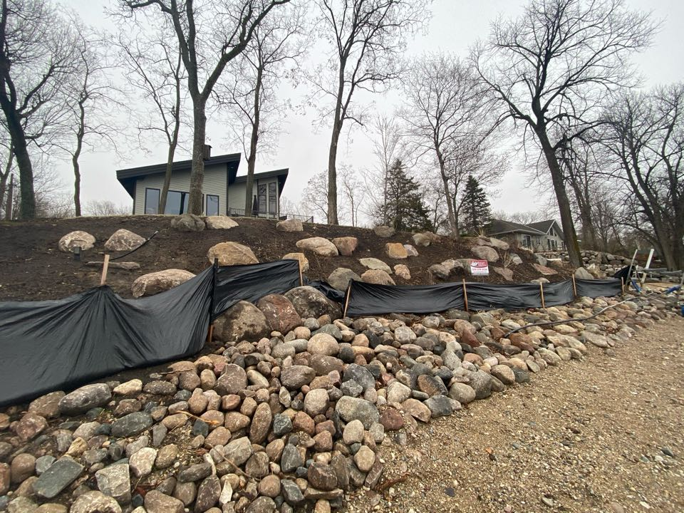 Litchfield, MN - Boulder outcroppings installed on hillside at Lake Minnie-Belle. Mulch and plants to be installed this spring.
