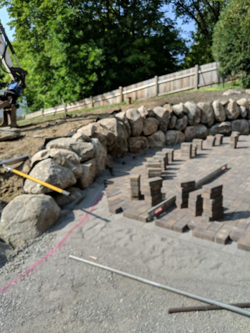 Excelsior, MN - New boulder wall down in excelsior for paver patio in the backyard.