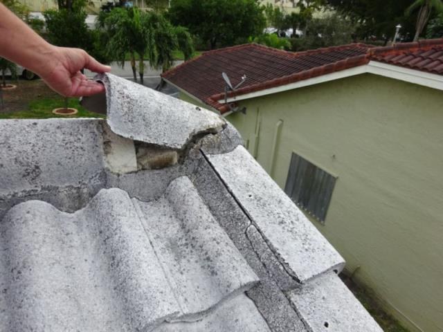 Coral Springs, FL - The homeowner suffered roof damage from Hurricane Irma