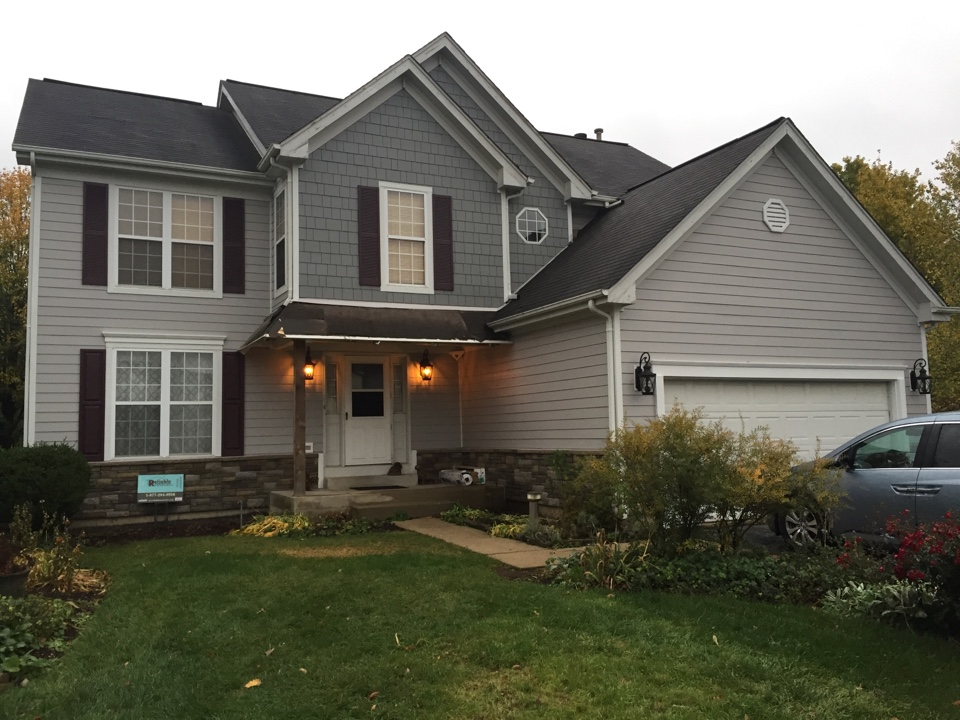 Aurora, IL - James Hardie Fiber Cement Siding, James Hardie Straight Edge Shake, Boral Versetta Stone, Alcoa Raised Panel Shutters and Fypon Mantels. Gloomy fall day in Aurora, IL