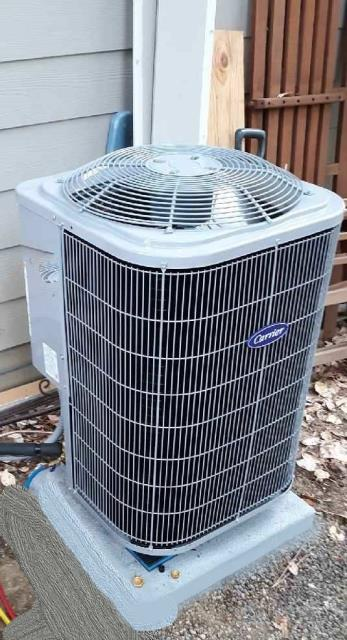Jacksonville, OR - Installation of a new Carrier heat pump to replace the old system. New system is more efficient working with a variable speed fan coil inside provides more efficient heating and cooling for the owner.