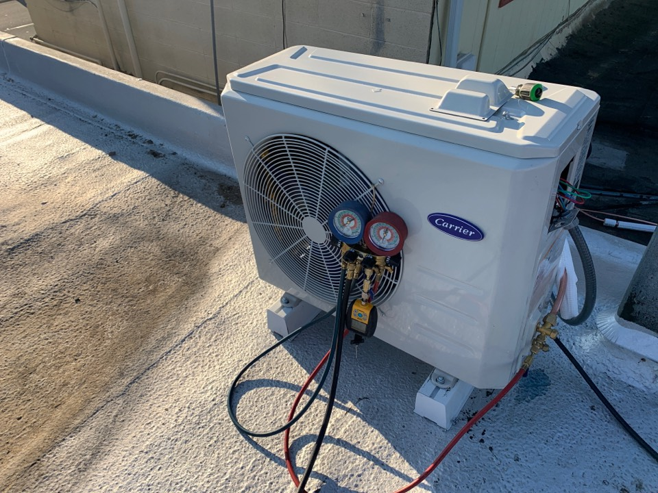 Medford, OR - Installing a new Carrier ductless mini split system for a small convenience store so they can get rid of their small window system. This will save them money, be cooler temperatures in the summer, provide warmth in the winter, and be safer against potential break ins!