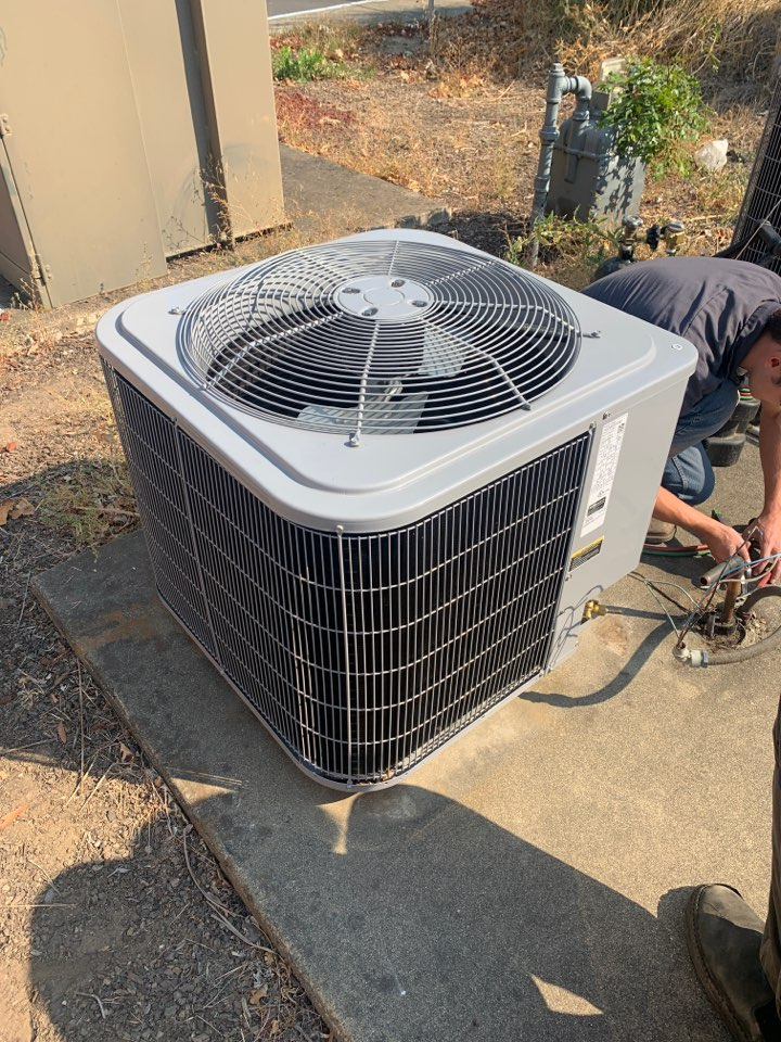 """Gold Hill, OR - Installation of a new condensing unit. This unit is a heat pump working with a gas furnace so owners will have a """"dual fuel"""" system meaning that the heat pump will provide until the temperature gets below 35 degrees and then the gas furnace can kick on maximizing efficiency for the system."""
