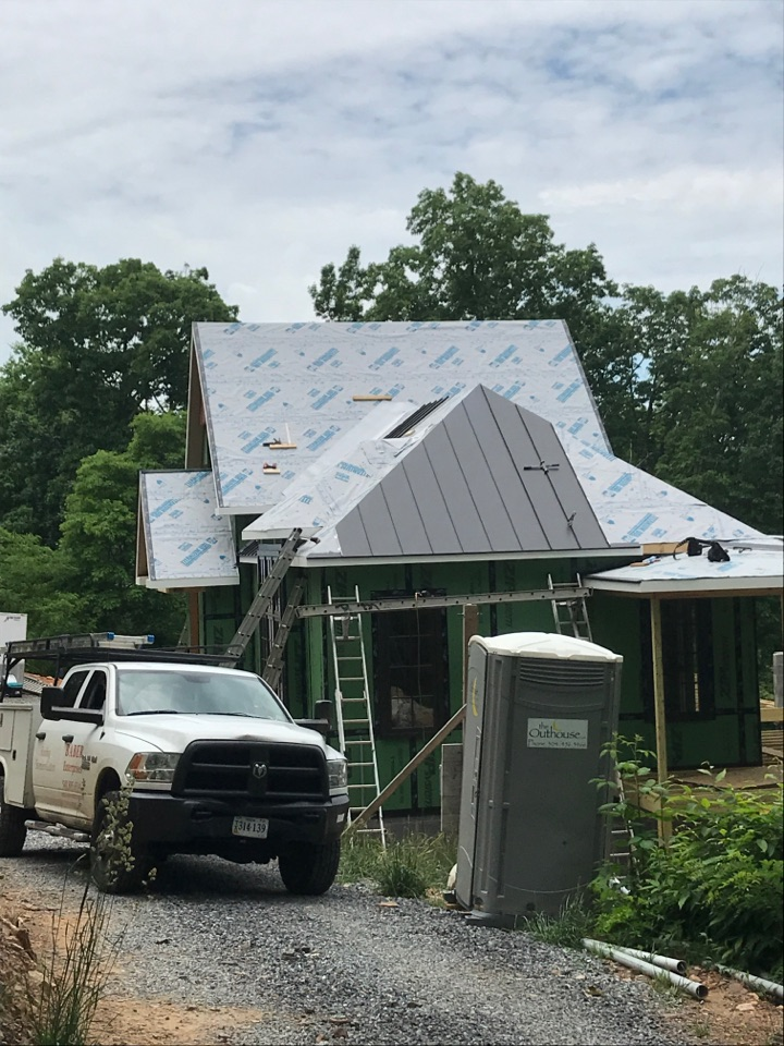 Hot Springs, VA - Installing a new standing seam metal roof on New construction home.