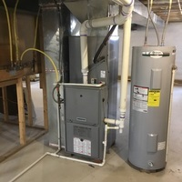Pataskala, OH - I provide the customer with an estimate for a new Carrier 98.5% Variable-Speed / Modulating 59MN7 Gas Furnace (Up to 100,000BTU), INFINITY Thermostat, and a Carrier up to 19 SEER Variable-Speed 24VNA9 Air Conditioner (Up to 3 ton) to replace their existing equipment.