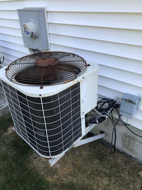 Westerville, OH - When cycling the 1996 Bryant unit I can hear the bearings are failing on fan. Removed fan from condenser, bearings are gritty and motor housing is too hot to touch. Motor is failing. Showing signs of pitting and burnt contacts. Recommend replacing.