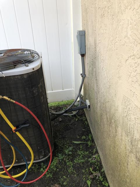 Reynoldsburg, OH - Upon arrival customer stated that the ac was not blowing cold air.  And added refrigerant R-22. System holds 7-8lbs. Found disconnect laying on ground. System is empty on refrigerant.