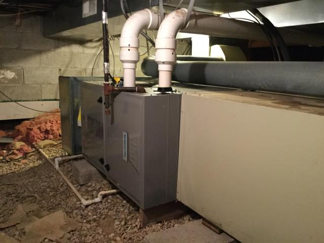Pataskala, OH - Tech cycled system on and immediately heard water sitting in exhaust, improper slope. Tech cut exhaust and secure with a proper slope to drain water back to inducer. Tech cleared clogged condensate trap and drain line. System is now heating/ operational with in manufacturing specifications