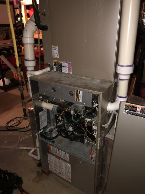 Powell, OH - I drained a gallon of water from collector box. I then replaced OEM Motor Surge Capacitor. Bryant gas furnace is operational at this time.