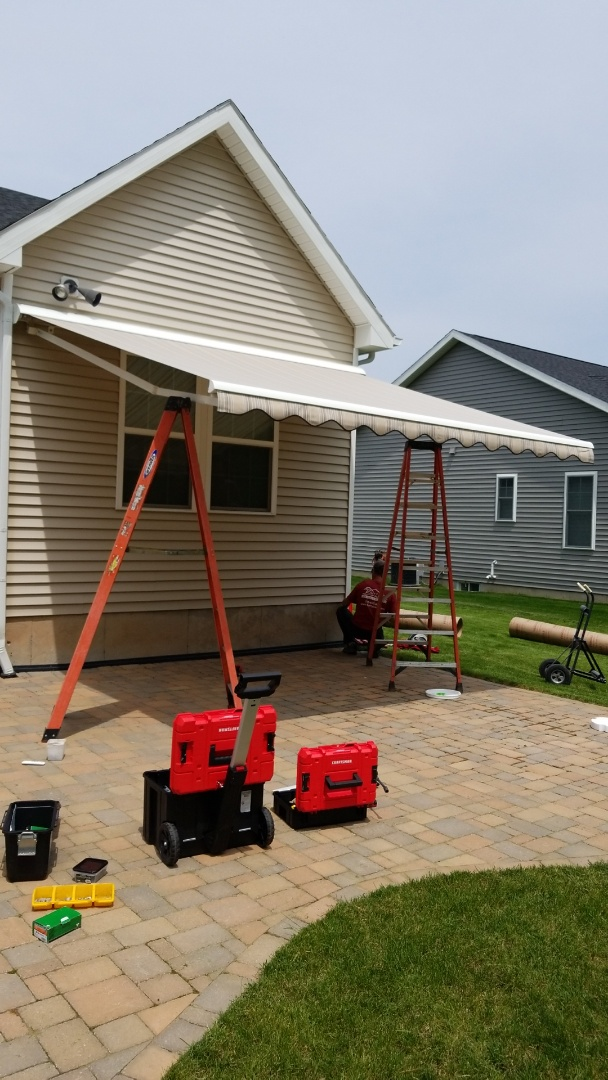 Cazenovia, NY - Installing retractable awning in Cazenovia