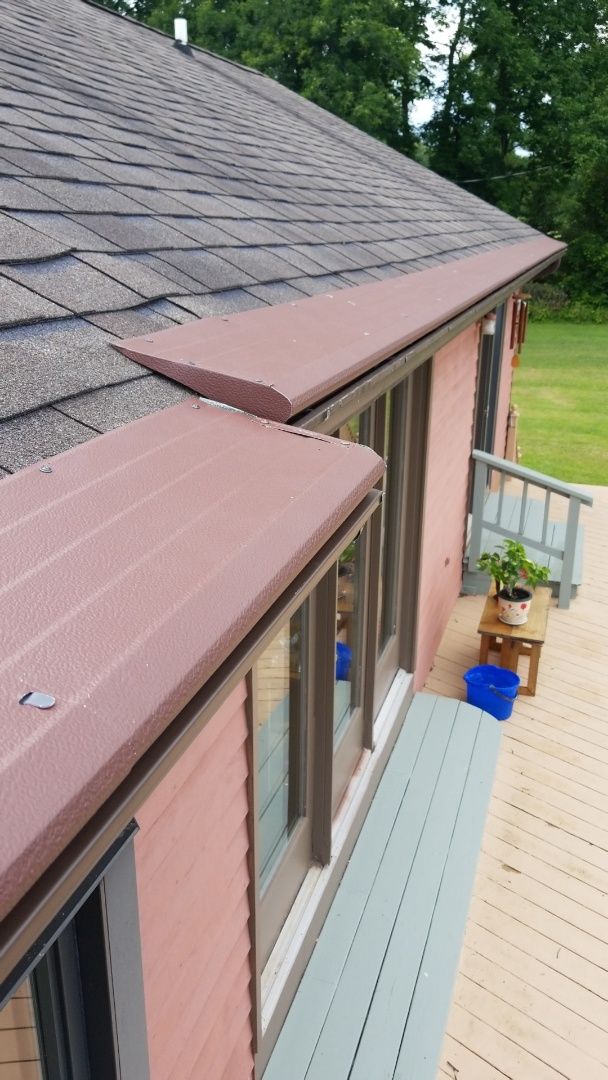 Manlius, NY - Installing gutter helmet so homeowners will never have to clean their gutters again