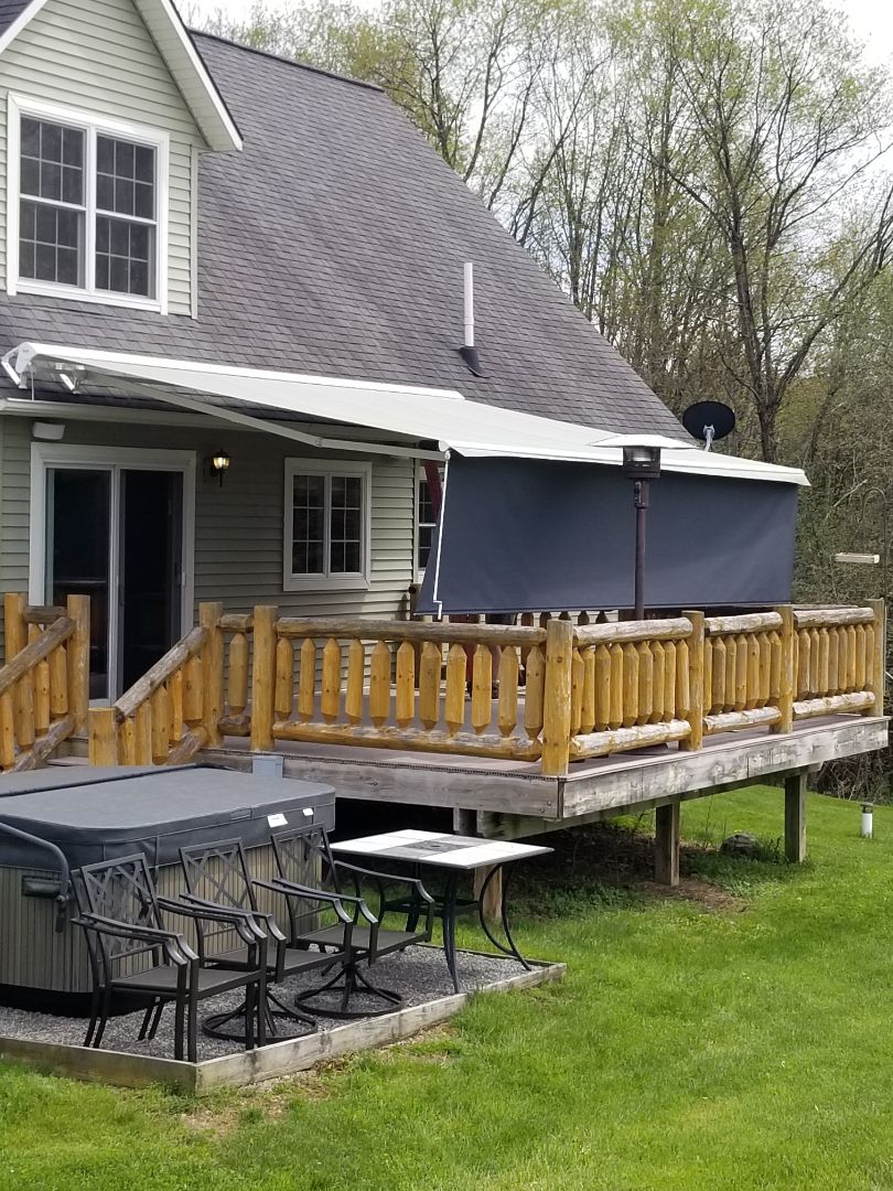 Cazenovia, NY - Installing top rated sonesta  retractable awnings that expand your outdoor living space and bring your backyard to life