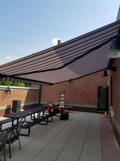 Fayetteville, NY - 20' WIDE SUNESTA AWNING INSTALLED OVER 2ND STORY BALCONY PATIO AREA.