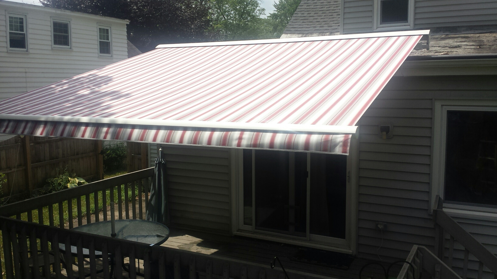 Syracuse, NY - Expanding outdoor living space with a retractable awning