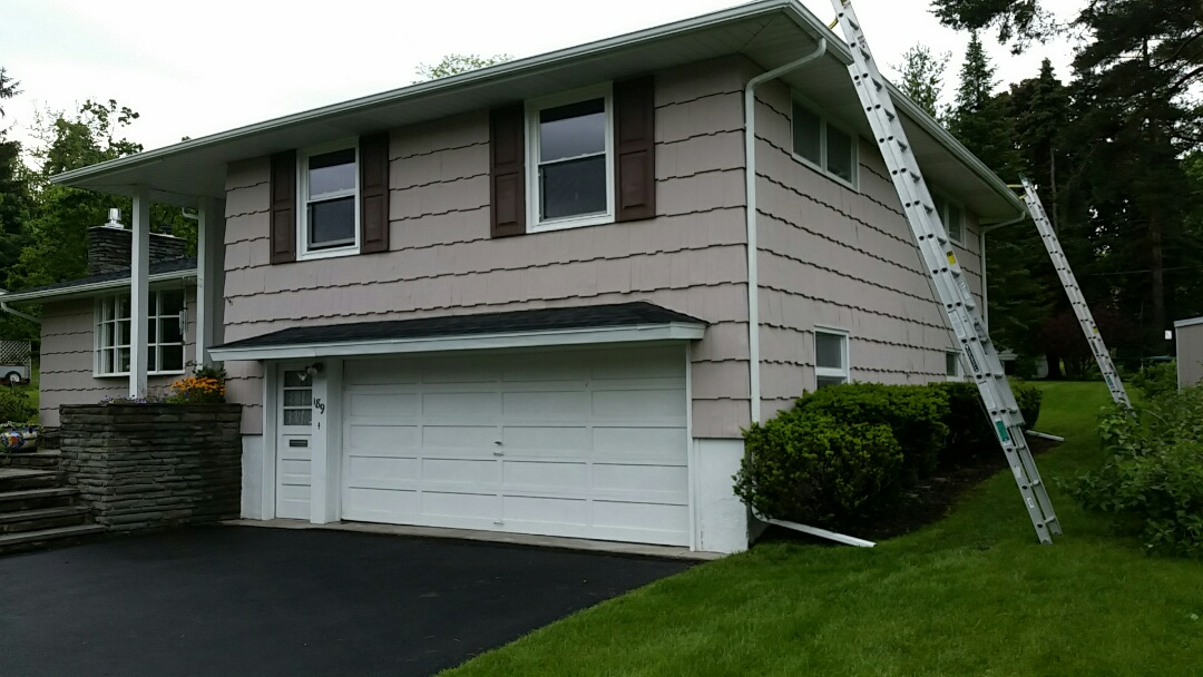 Syracuse, NY - Capture and divert the water away with a new rain gutter system