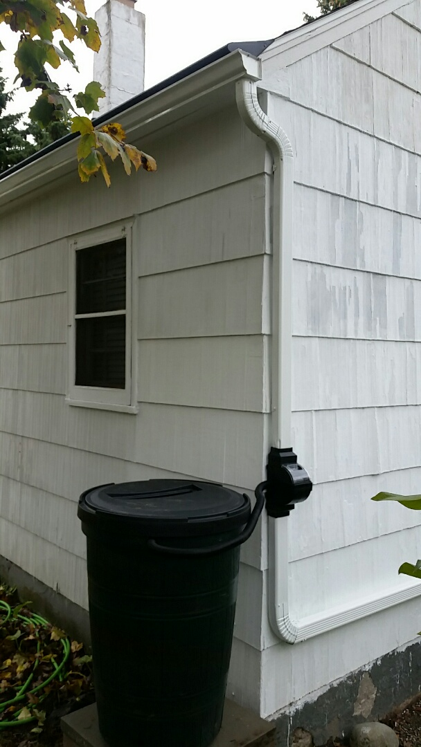Syracuse, NY - Gutters gutter helmet and a rain barrel