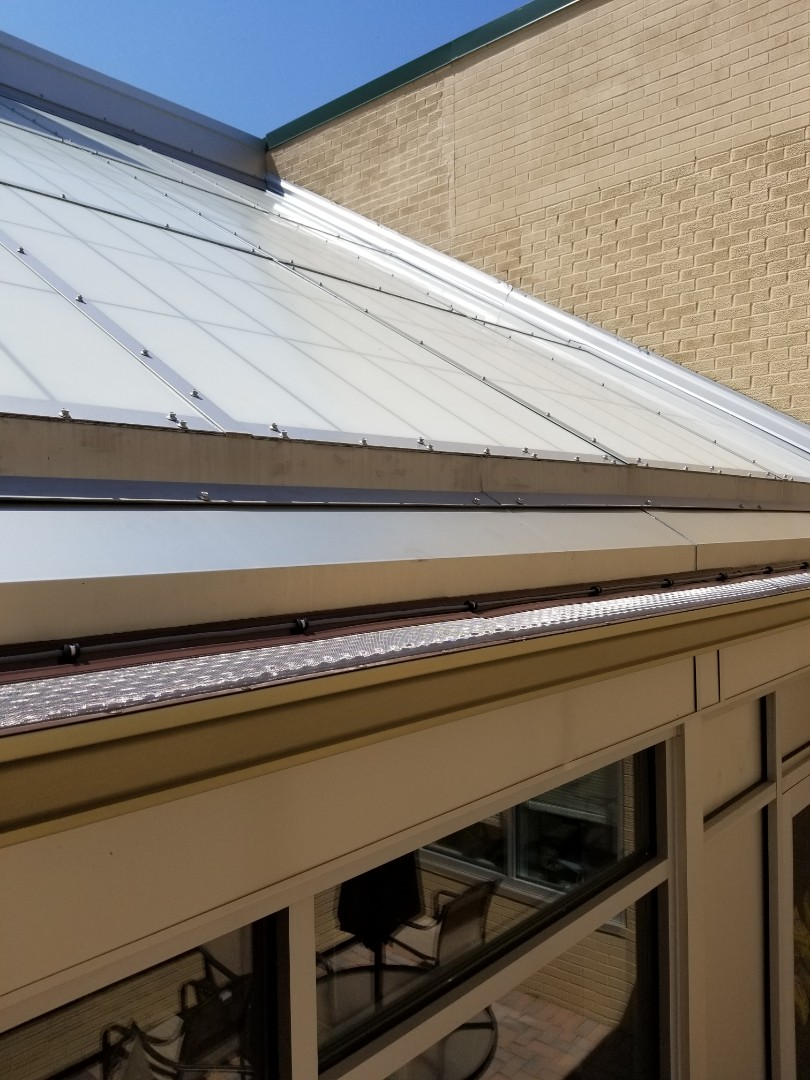 Fayetteville, NY - Commercial gutters with microscope and heat cable