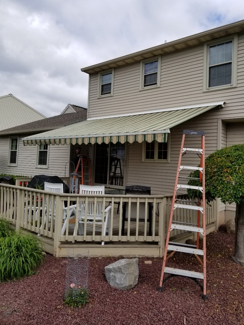 Syracuse, NY - New fabric on a 20 year old  Sonesta awning.,still giving great service and enjoyment