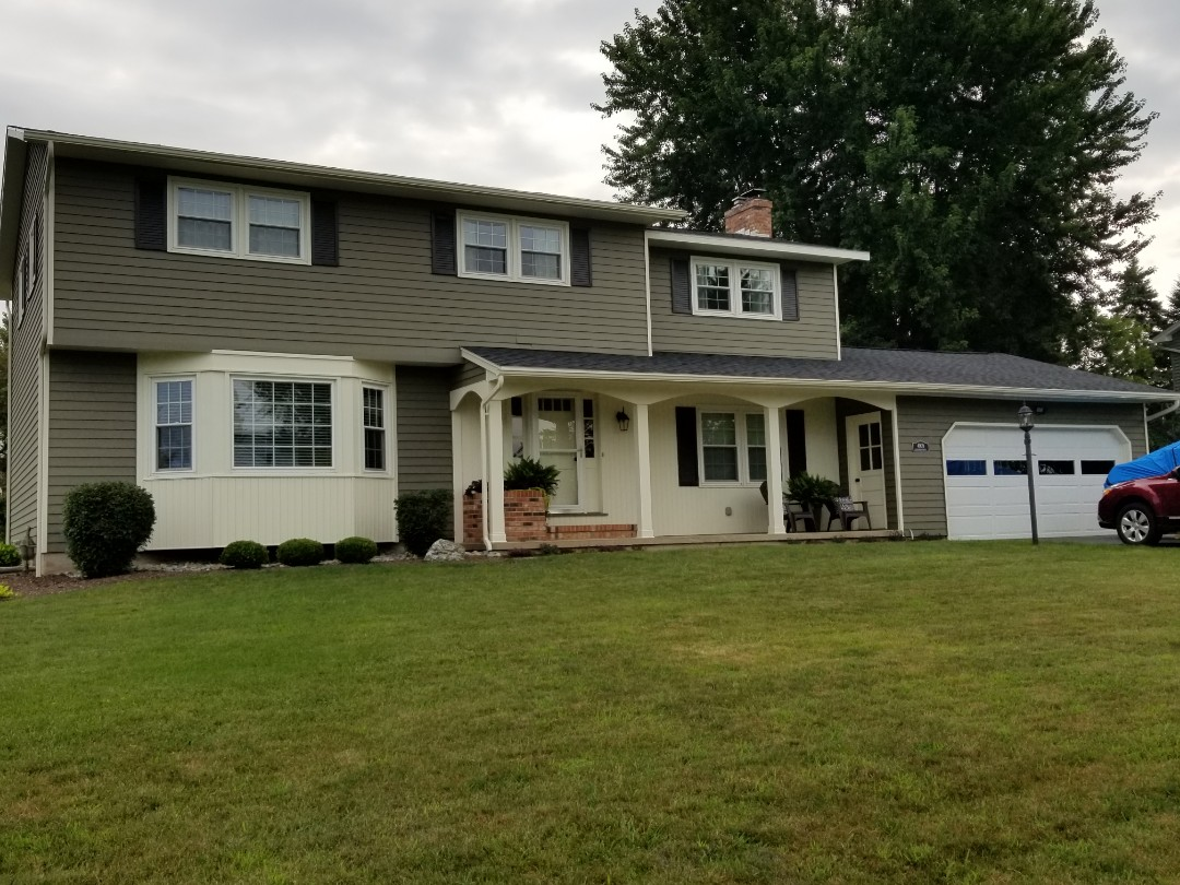 Manlius, NY - Full house new gutters. Almond butter is a perfect color match to the trim.