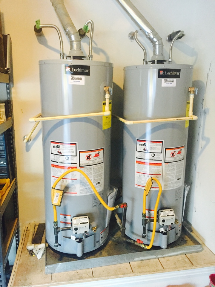 Installing two new Lochinvar 50 gallon gas water heater in garage