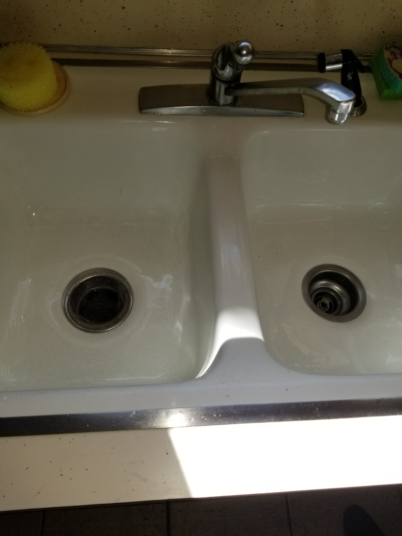 Kitchen sink is stopped up need repair. clear kitchen sink stoppage by removing p-trap and clearing stoppage