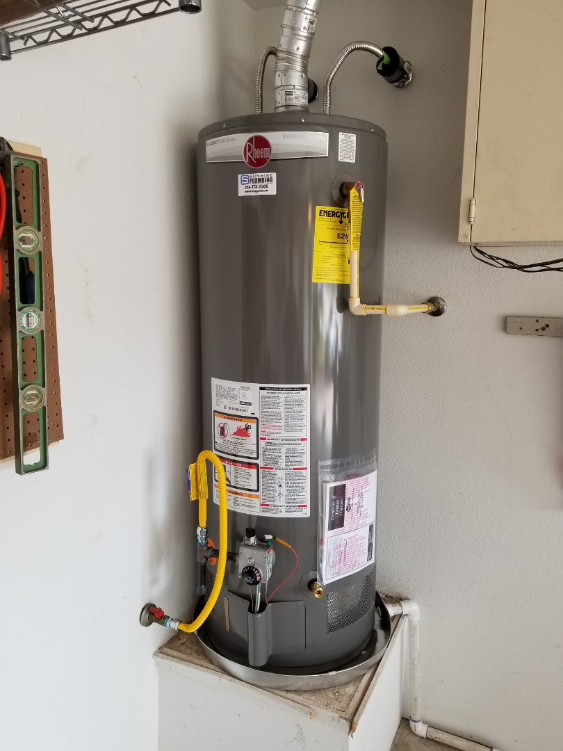 Homeowner has 15 year old water heater wants to replace. Install new 50 gallon 8 year warranty water heater in garage. Sachse Plumbers.