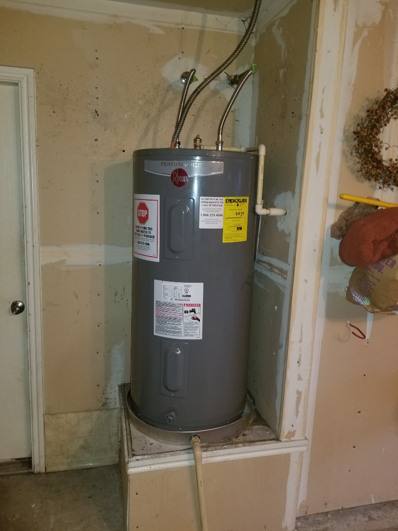Water heater  In garage is leaking on top. Need repair. Install new  Client provided water heater. Rockwell plumbers