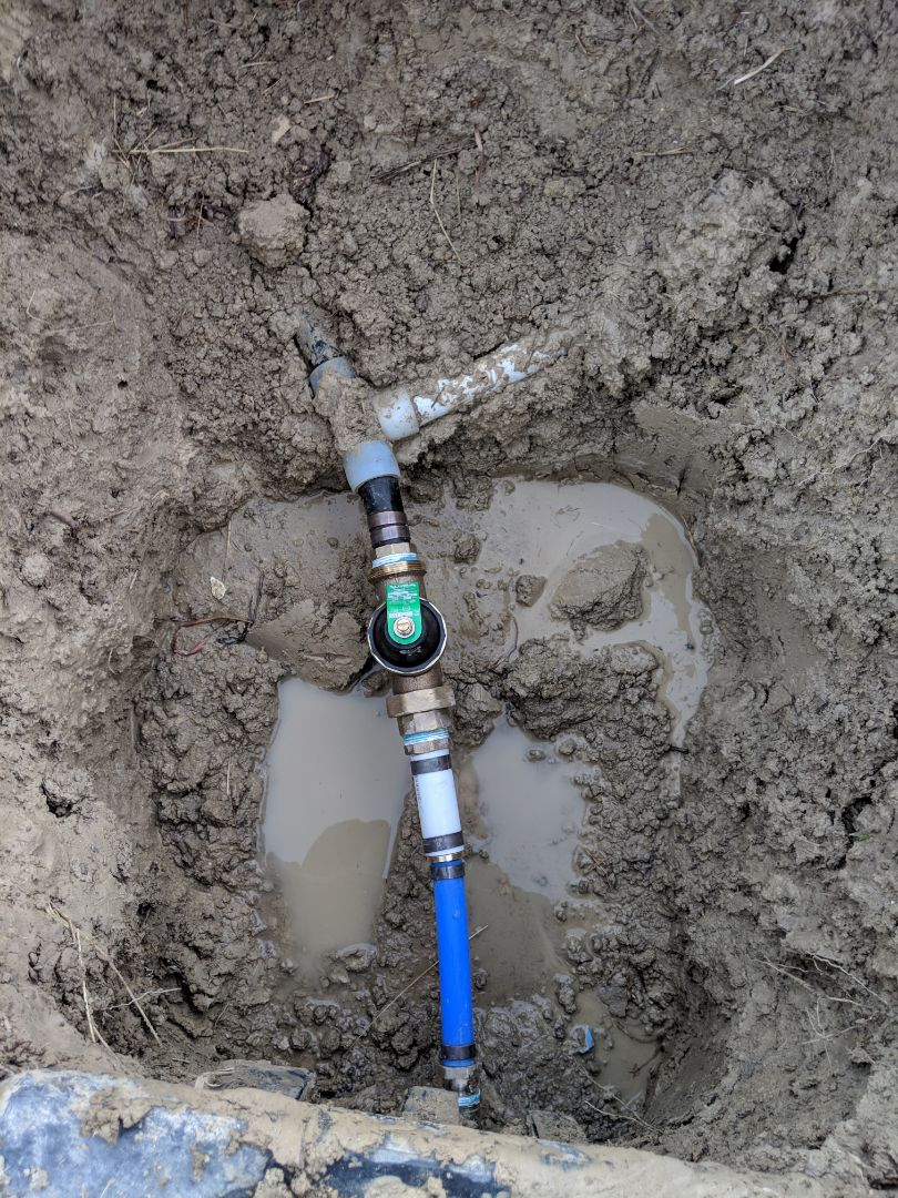Water pressure to house at 98psi needs repair. Install new pressure reducing valve in ground near water meter