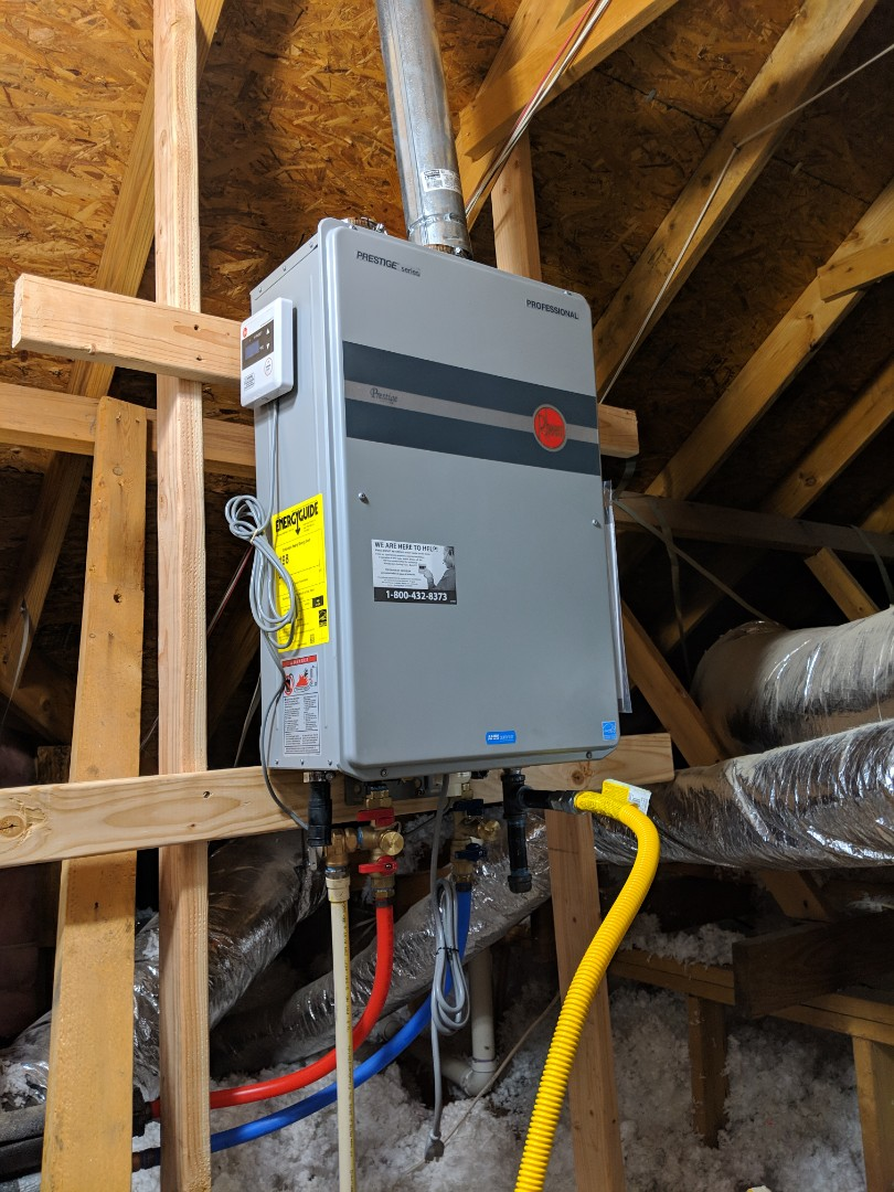 19 year old water heater in attic needs to be replaced. Install new Rheem tankless water heater with 12 year warranty.