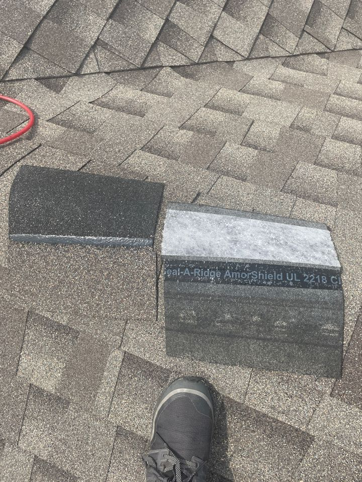 Milliken, CO - Here is a picture of the GAF Armorshield 2 ridge shingles. You can see in the picture there is a scrim backer on the shingle as well as rubber formulated into the shingle to create a stronger shingle that will stand up to Colorado's hail. Call the team at Reliable Roofing and Restoration today and see how we can help stop replacing your roof every hail storm.