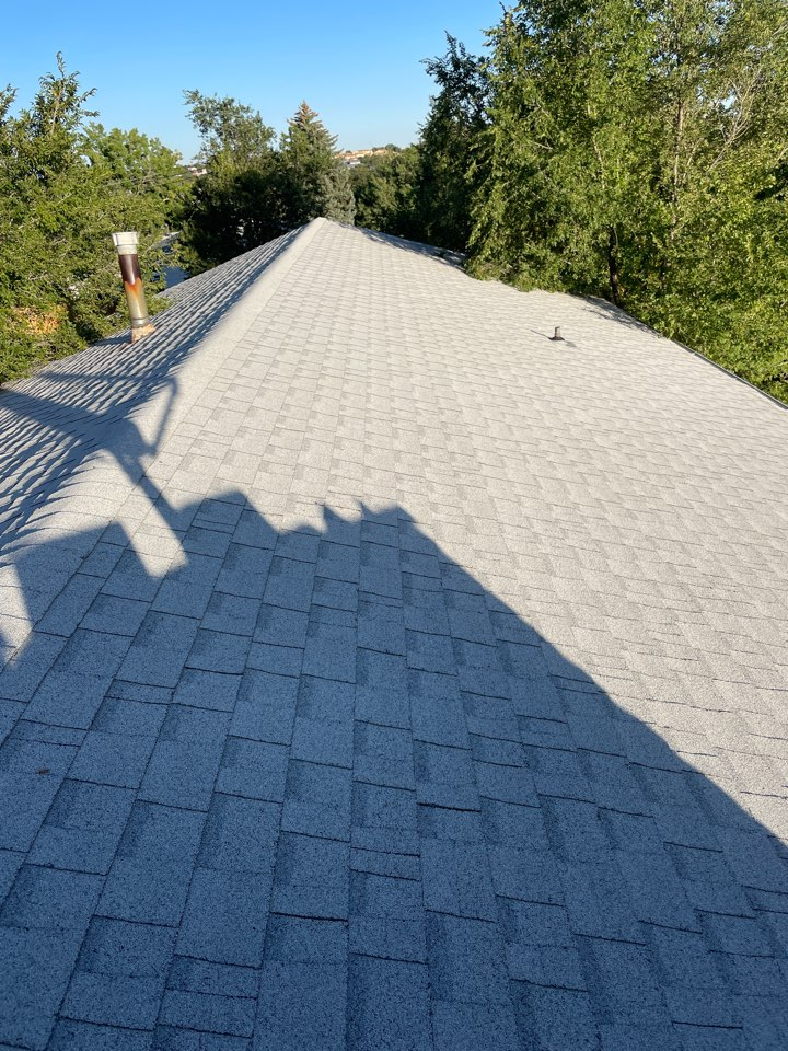 Colorado Springs, CO - Reliable Roofing and Restoration. Evaluating this roof which was impacted by a recent hail storm. Whatever your roofing needs are please give us a call today. We're here to help!