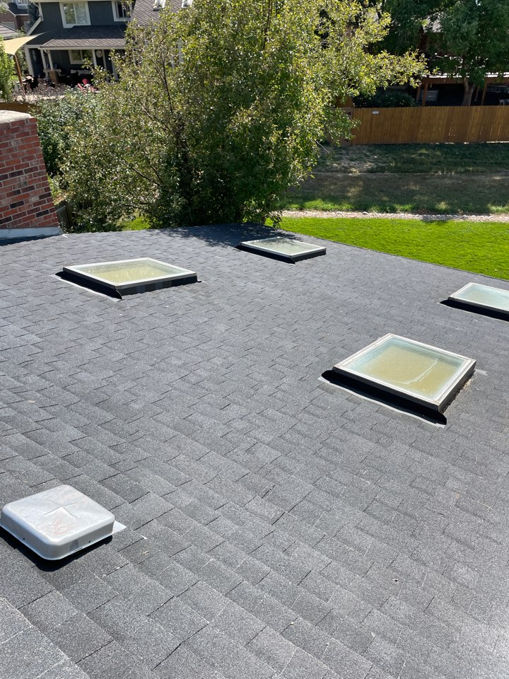 Centennial, CO - After a recent hail storm this roof and skylights were broken and the roof is damaged. Give the team at Reliable Roofing and Restoration a call today for your free roof and property inspection.