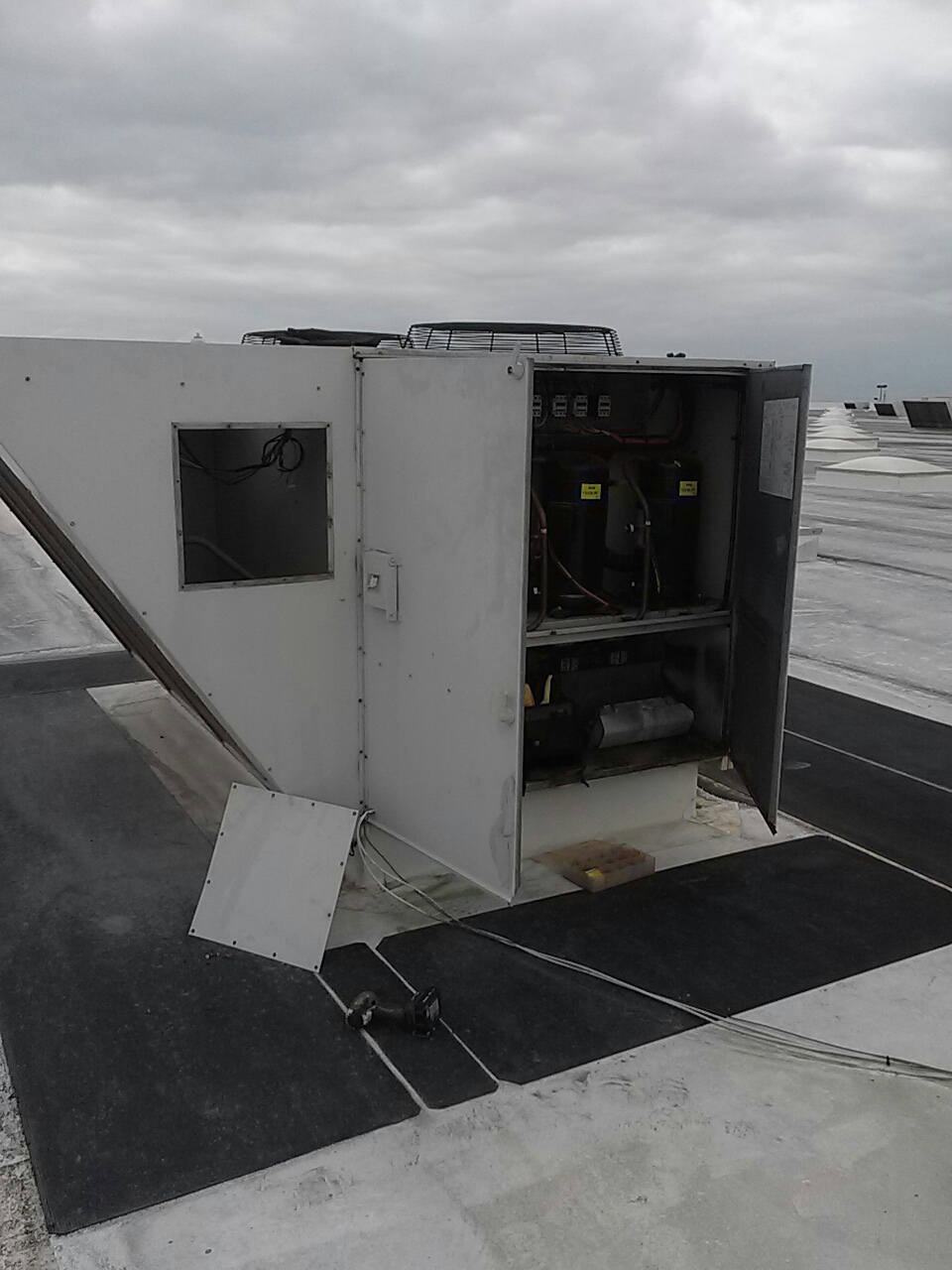 Cocoa, FL - Air conditioning service call and repair on commercial rooftop package unit with a high-voltage short.