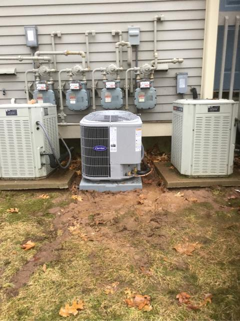 Branford, CT - Installed a Carrier Comfort 80% AFUE 70000 BTUH Multipoise Gas Furnace 58STA070-1-12 and Carrier 2 Ton 13 SEER Residential Air Conditioning System with a Honeywell Thermostat.