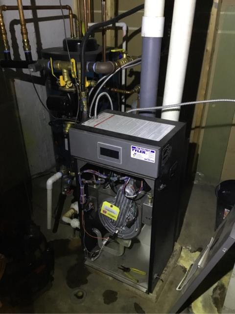 Stratford, CT - Performing annual maintenance on a Burnham Alpine gas boiler that we installed in 2016.