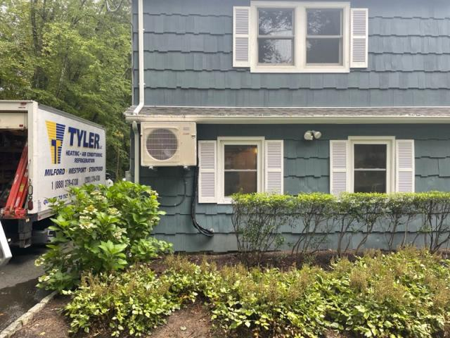 Westport, CT - Installed a Mitsubishi 2 Ton Ductless Heat Pump.  Mounted system to side of house because house in a flood zone.