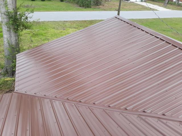 Lynn Haven, FL - Ready for final inspection on this brown tuff rib metal roof in Lynn Haven!