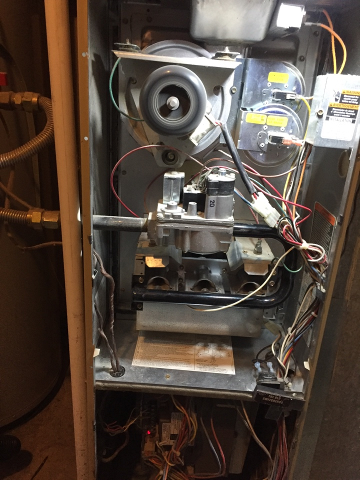 Salt Lake City, UT - Preforming a tune up on a carrier furnace.