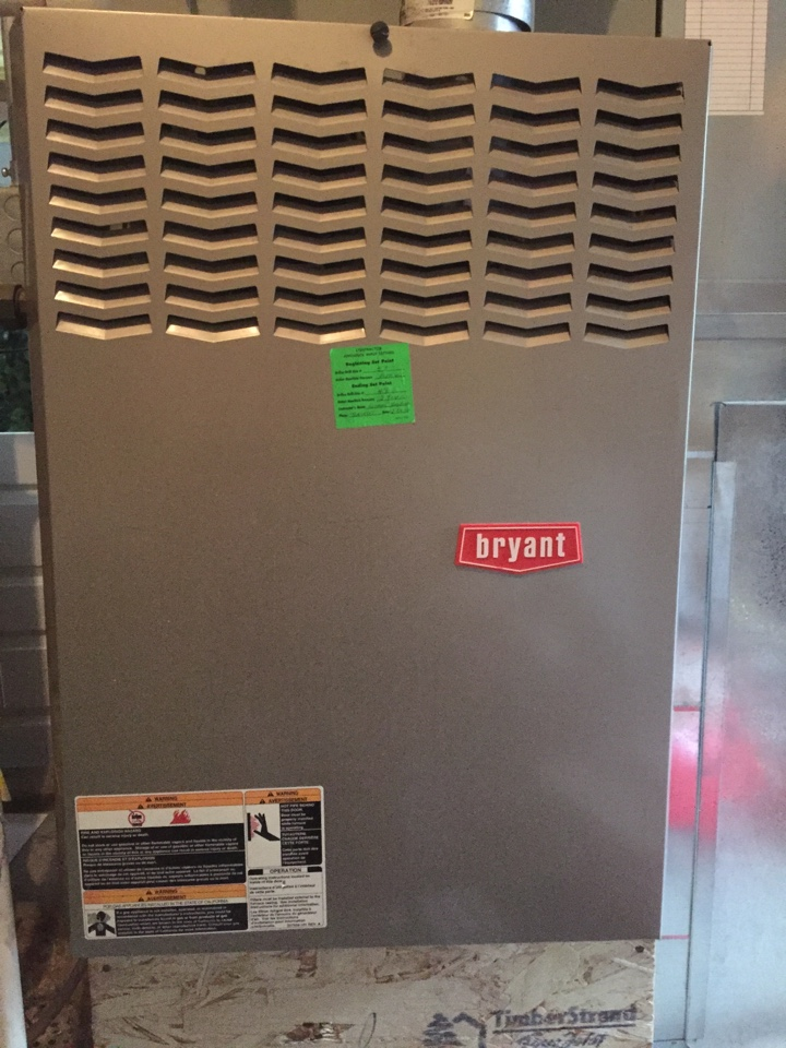 Lehi, UT - Performing an air conditioner tune up on a Bryant system.