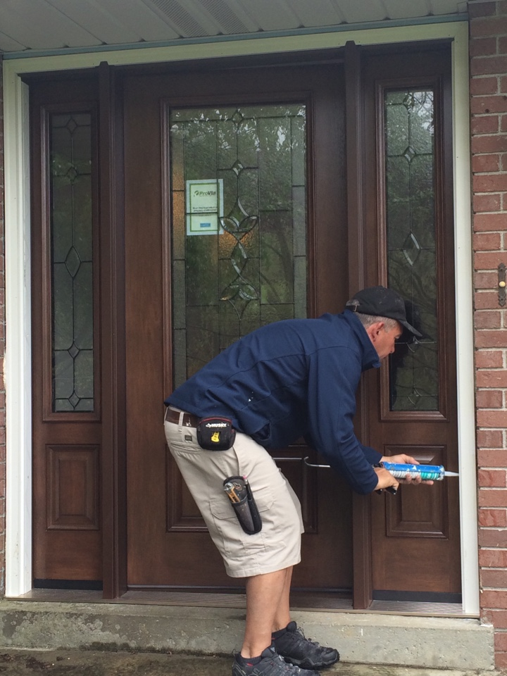 New Kensington, PA - Just installed a Renewal by Andersen replacement front door with sidelites. Certified master installer Dave is caulking and weather proofing the exterior