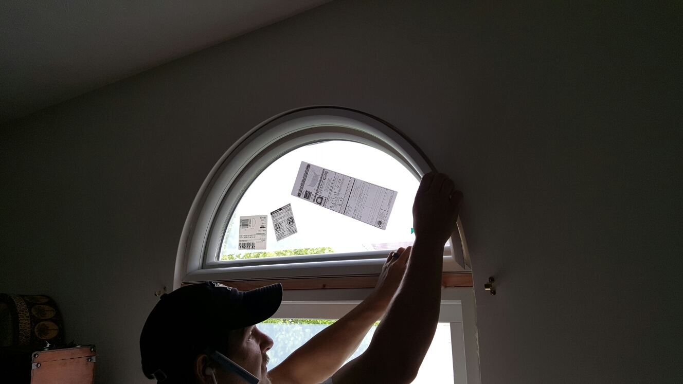 New Kensington, PA - here's a circle top trim kit being placed on a Renewal by Andersen window by our certified master installers!!! It's a great job!!!
