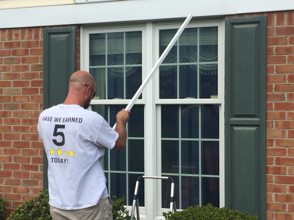 Greensburg, PA - Final touches being applied on the Renewal by Andersen replacement double hung windows just installed by Josh and Shawn. Looks great !!