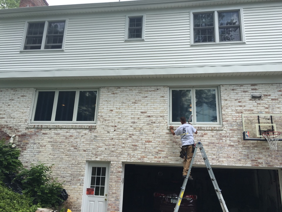 Pittsburgh, PA - Renewal by Andersen Master Installer Scott insulating around new replacement windows. One of the many reasons our windows and installation provide the highest amount of energy efficiency for your home.