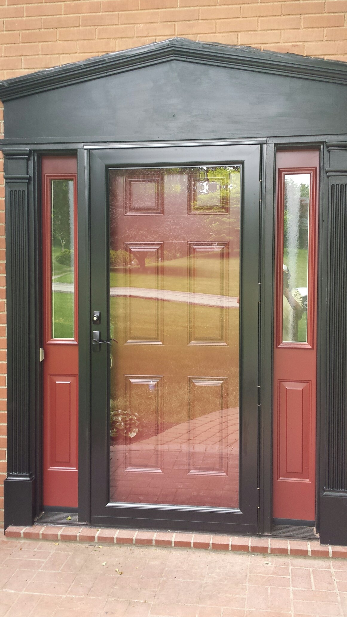 Pittsburgh, PA - New Provia entry door with sidelites  and storm door from Renewal by Andersen.  Security and beauty for years to come.