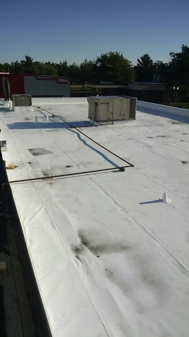 Menomonie, WI - Servicing rooftop units