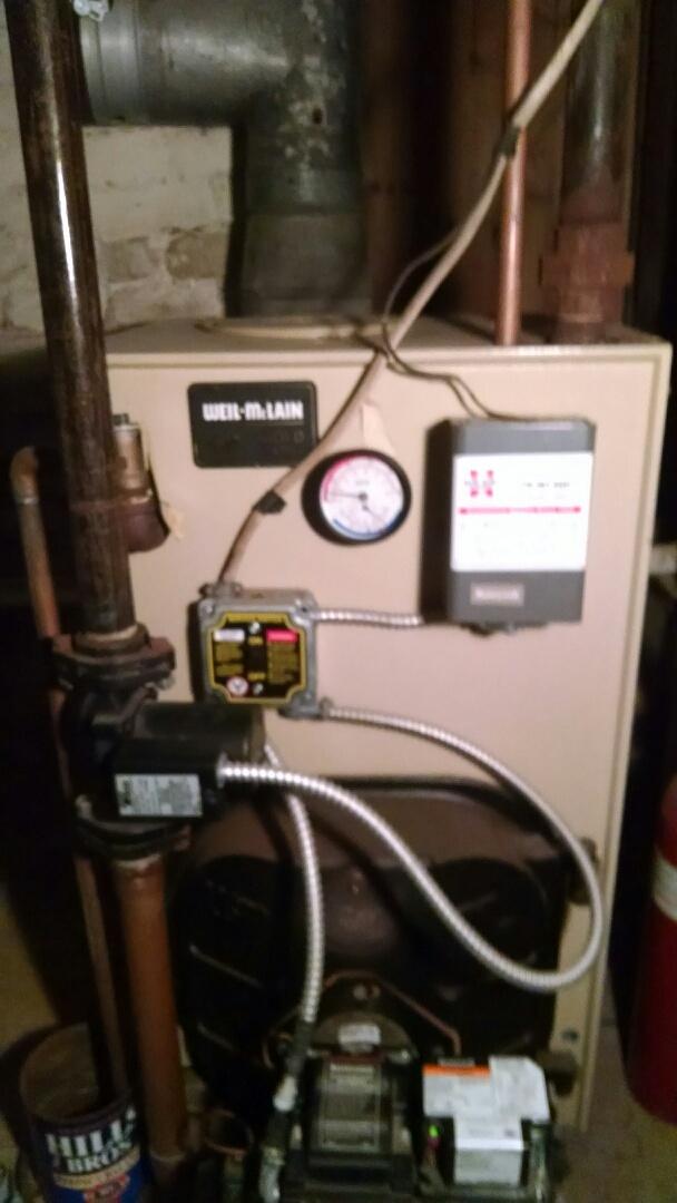 Menomonie, WI - Servicing oil boiler