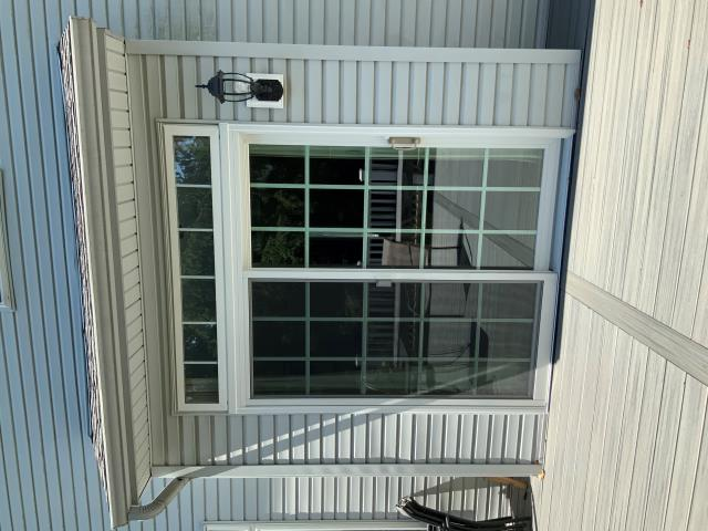 Macungie, PA - Today I visited a homeowner that got a beautiful gliding patio door with grilles installed. Their last door would not lock. Now with the new patio door not only do they have a door lock they also have the wonderful foot lock.