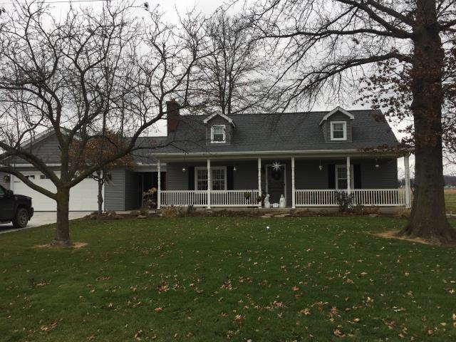 Strasburg, OH - Installed GAF pewter gray Timberline HD shingle roof, installed Provia Granite Triple 4 vinyl siding, and installed white gutters and downspouts.