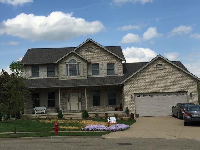 Dover, OH - A beautiful example of GAF Mission Brown Timberline HD shingles and Clay gutters installed