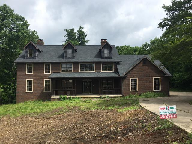 Cambridge, OH - What a gorgeous setting for this two story with a new GAF HD Timberline Charcoal roof